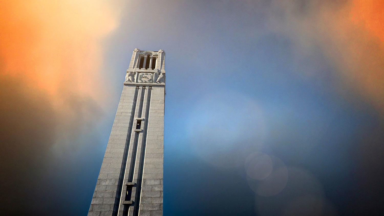 NC State Belltower with orange sky