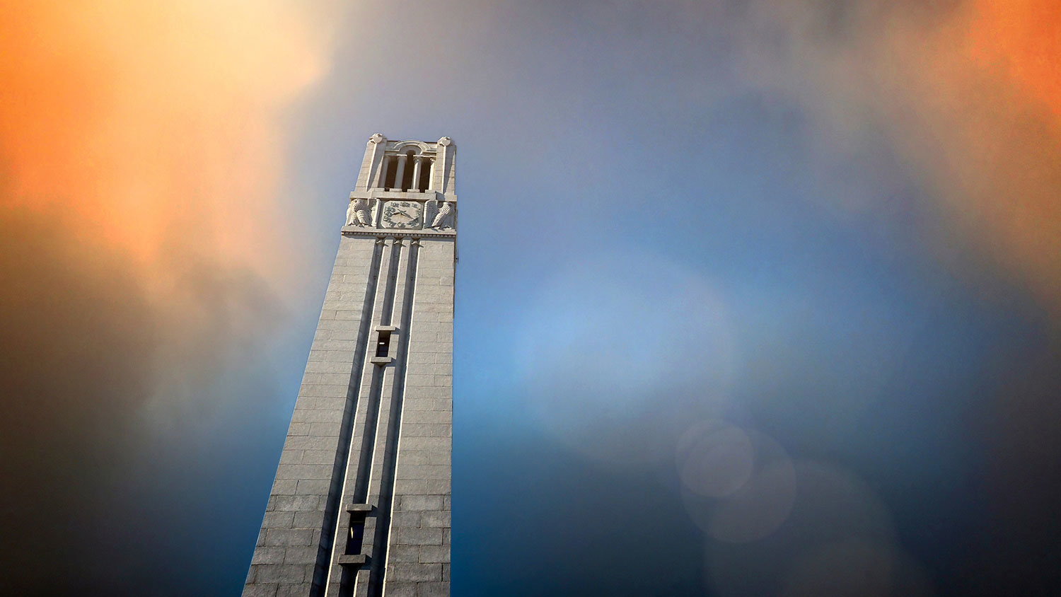 NC State Belltower with orange sky
