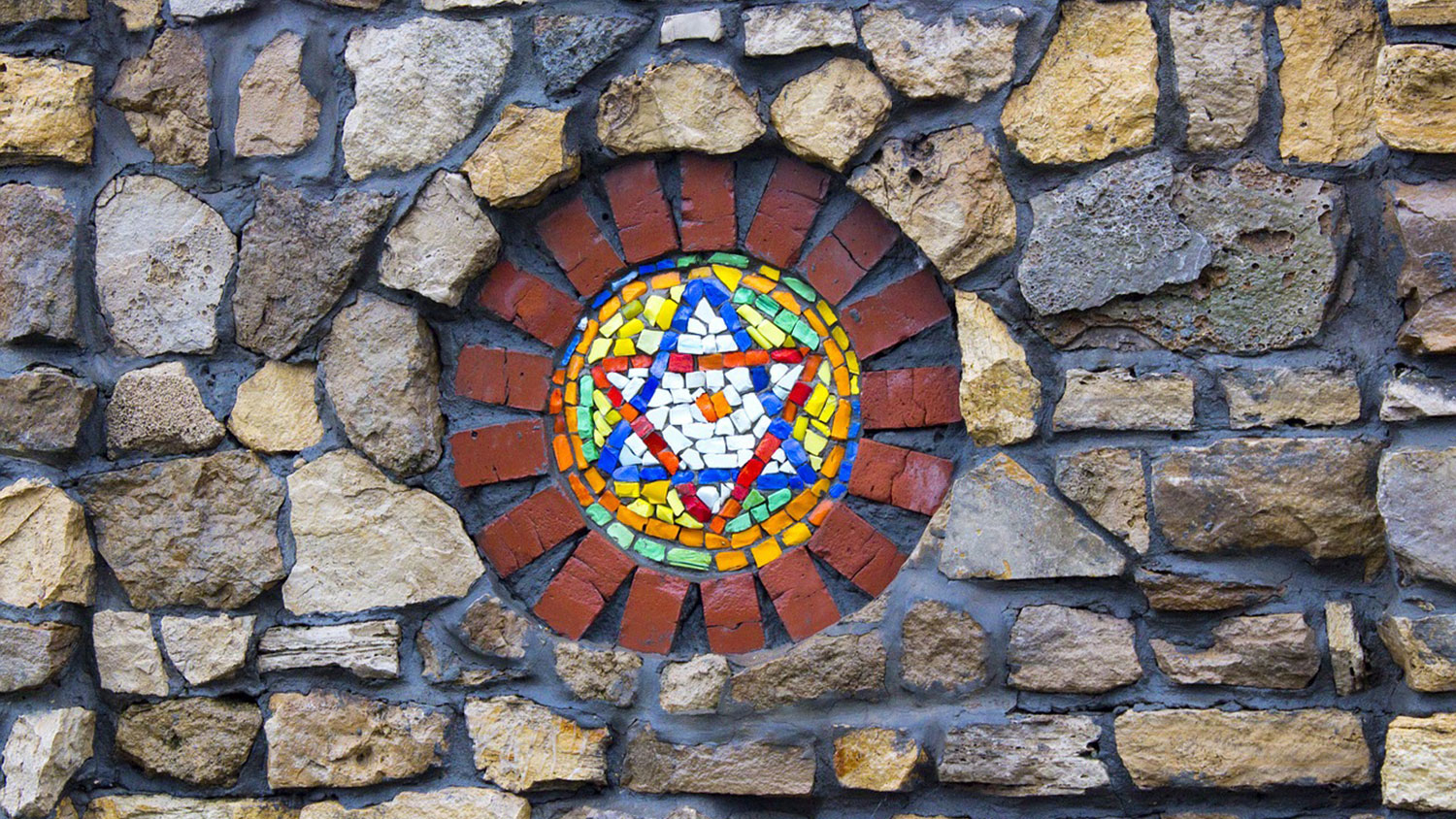 Star of David in mosaic within a stone wall