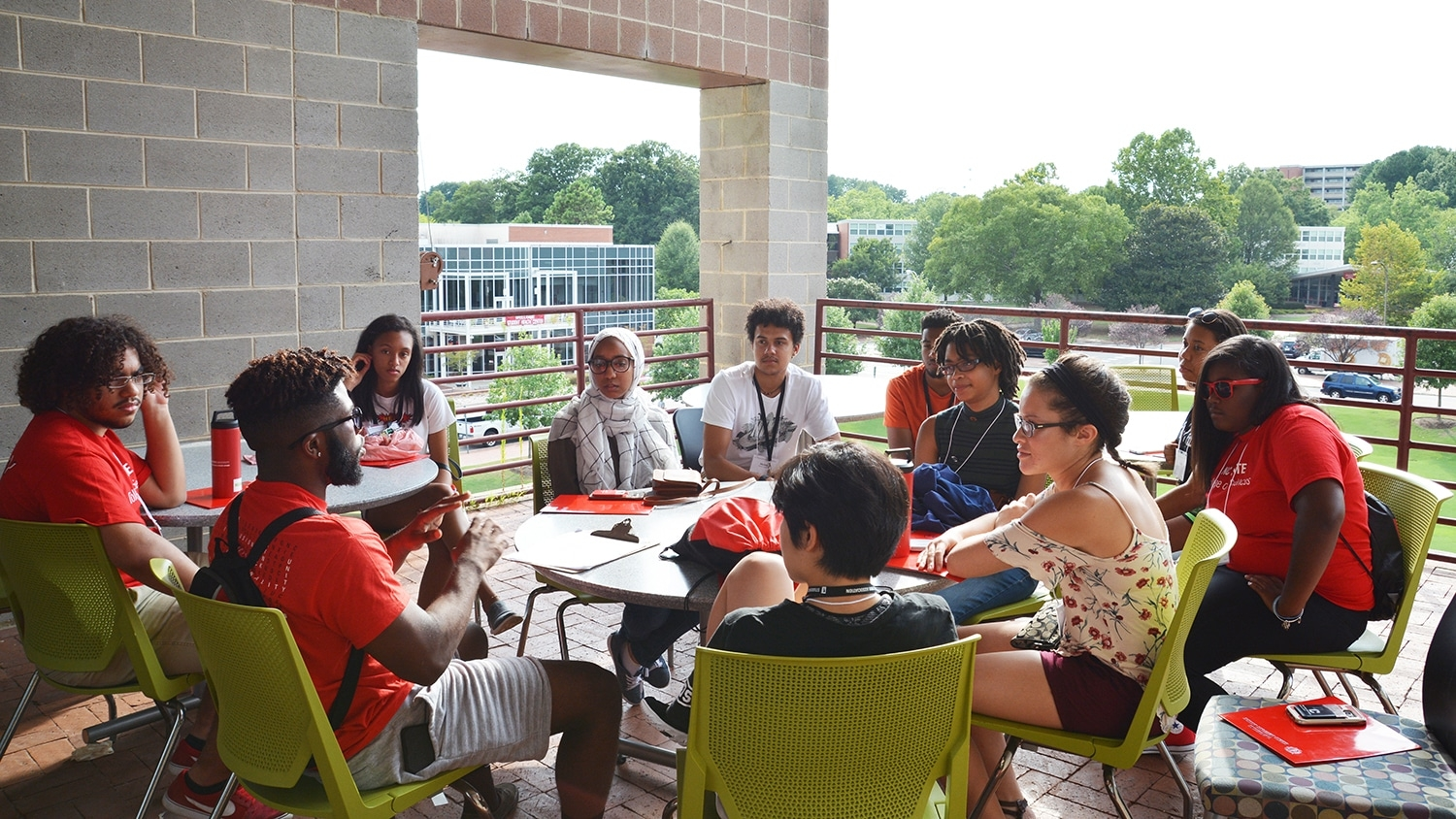 Students sitting around a table participate in a discussion session during the Symposium for Multicultural Scholars