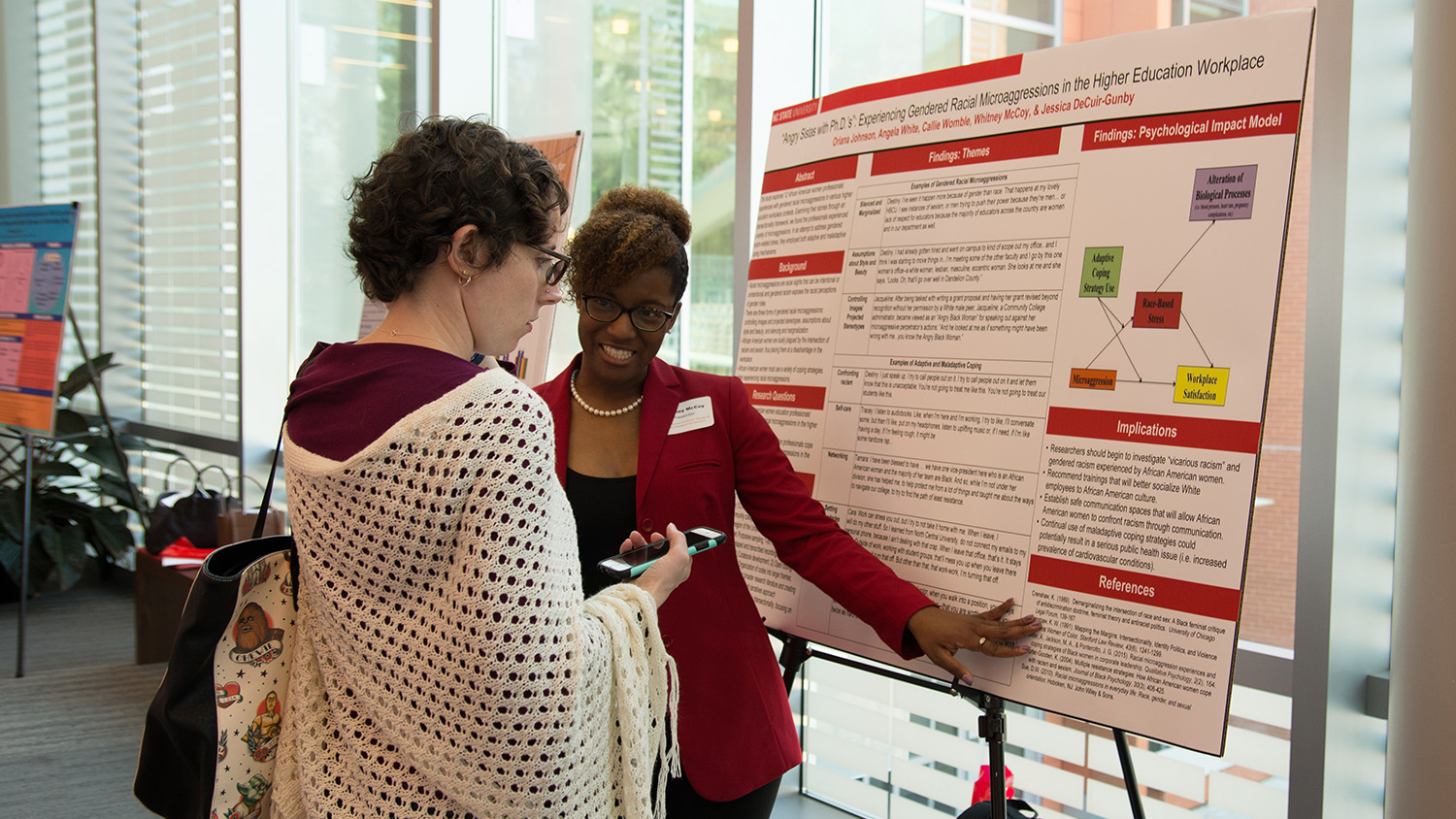 A poster presentation being discussed at the Symposium