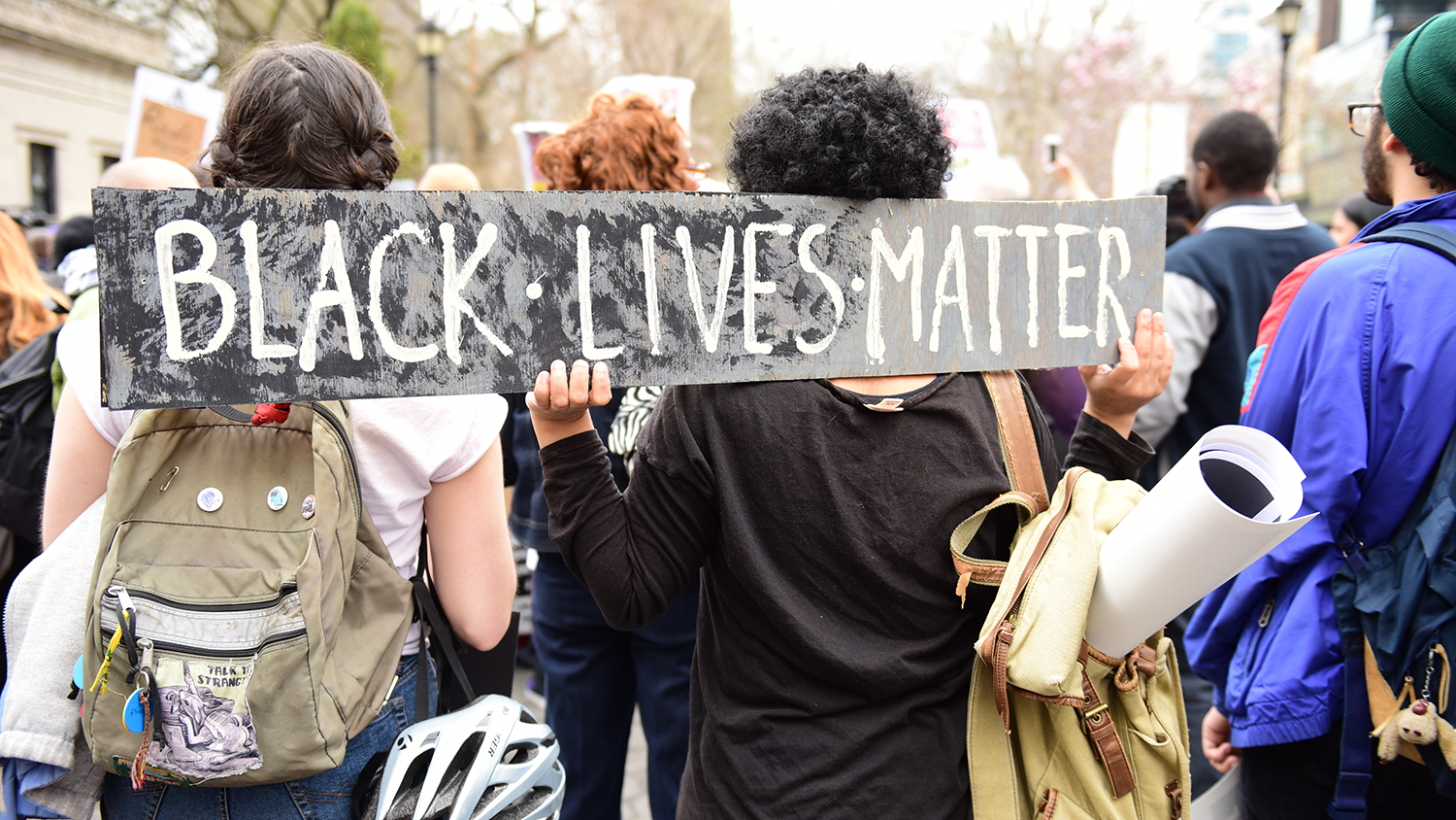 students with a Black Lives Matter sign