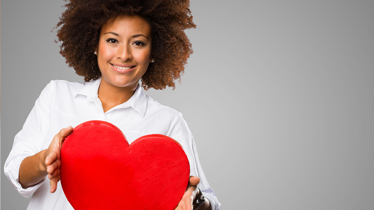 Woman holding large red heart