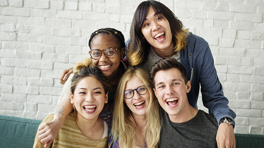 Group of happy students together