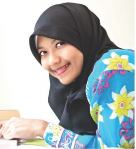 Young, smiling woman in hijab