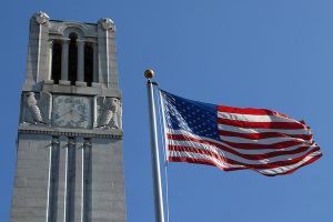 American flag with NC State Belltower