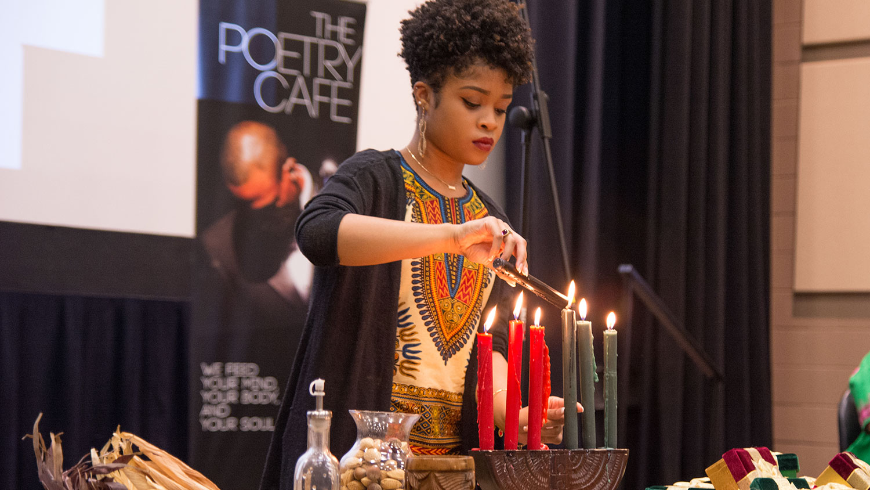 Lighting candles at Kwanzaa 2016