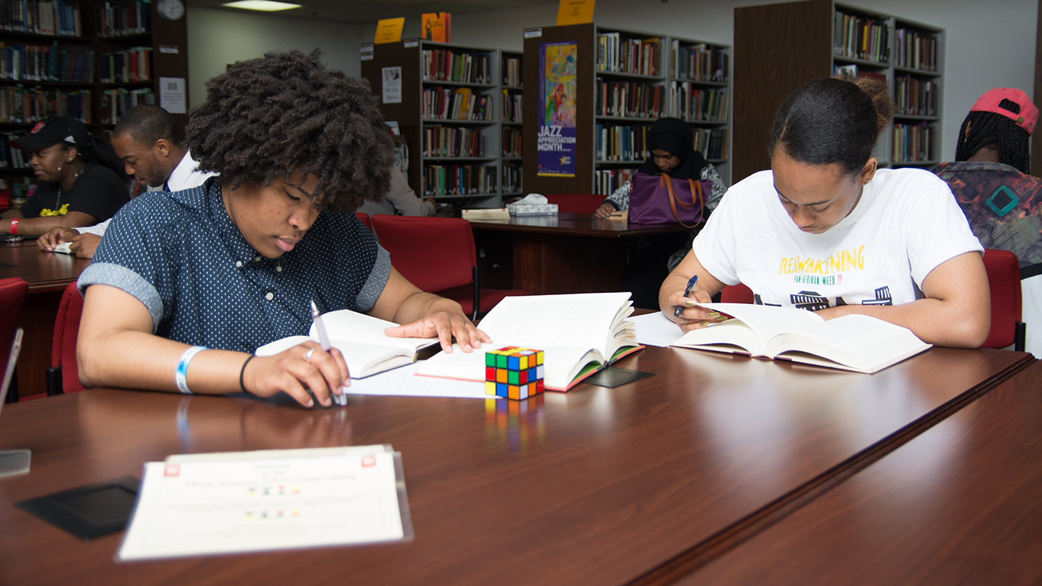 Students studying in African American Cultural Center library