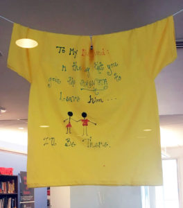 Clothesline Project t-shirt on display