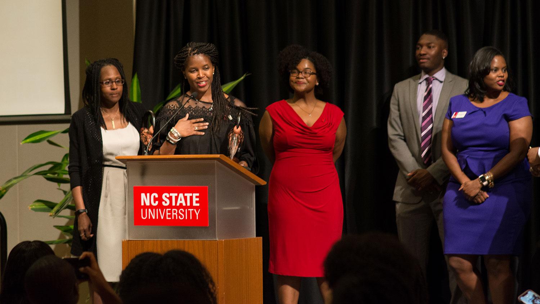 Ebony Harlem Award recipient at podiium