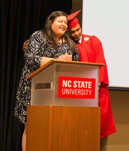 A graduate embraces Marcela Torres-Cervantes of MSA