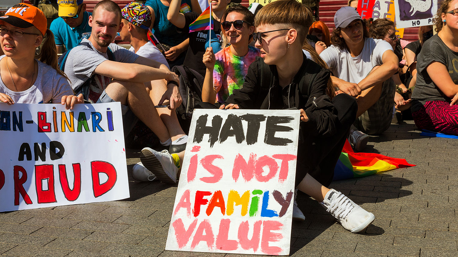 "Student protesting with sign saying ""Hate is not a family value."""