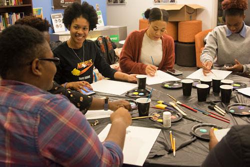 Painting workshop participants enjoy the process