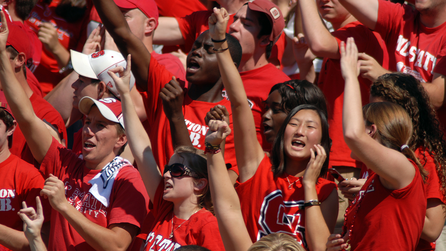 Wolfpack students cheer at athletic event