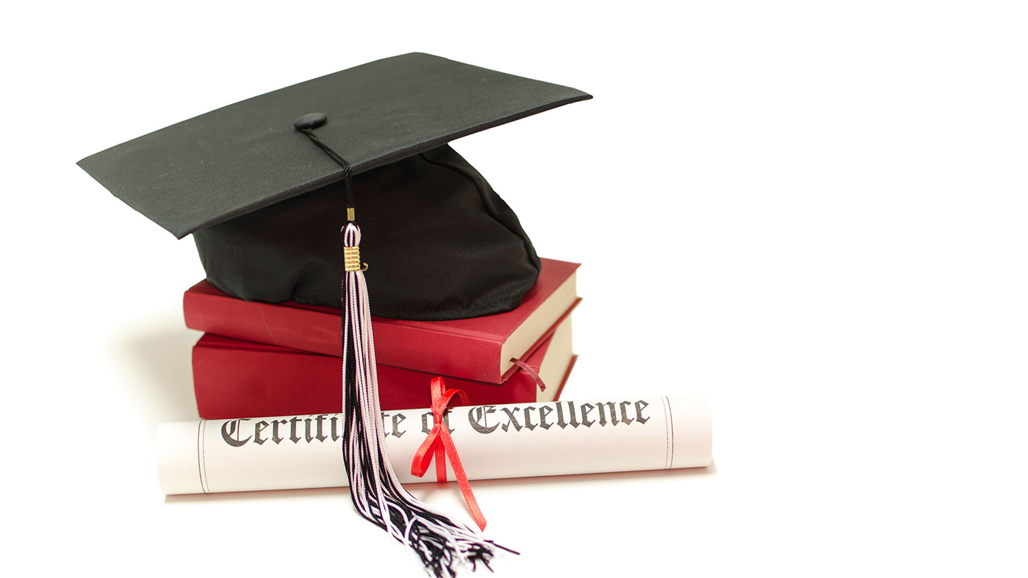 Mortarboard, books and certificate of excellence
