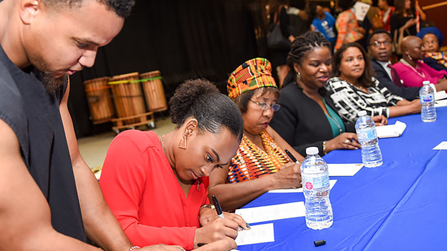 students and members of the community engaging at an event
