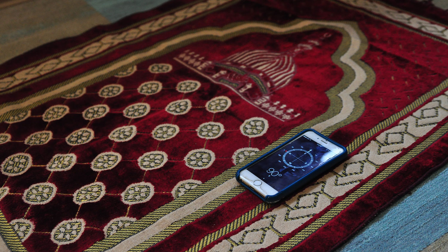 Prayer rug and compass