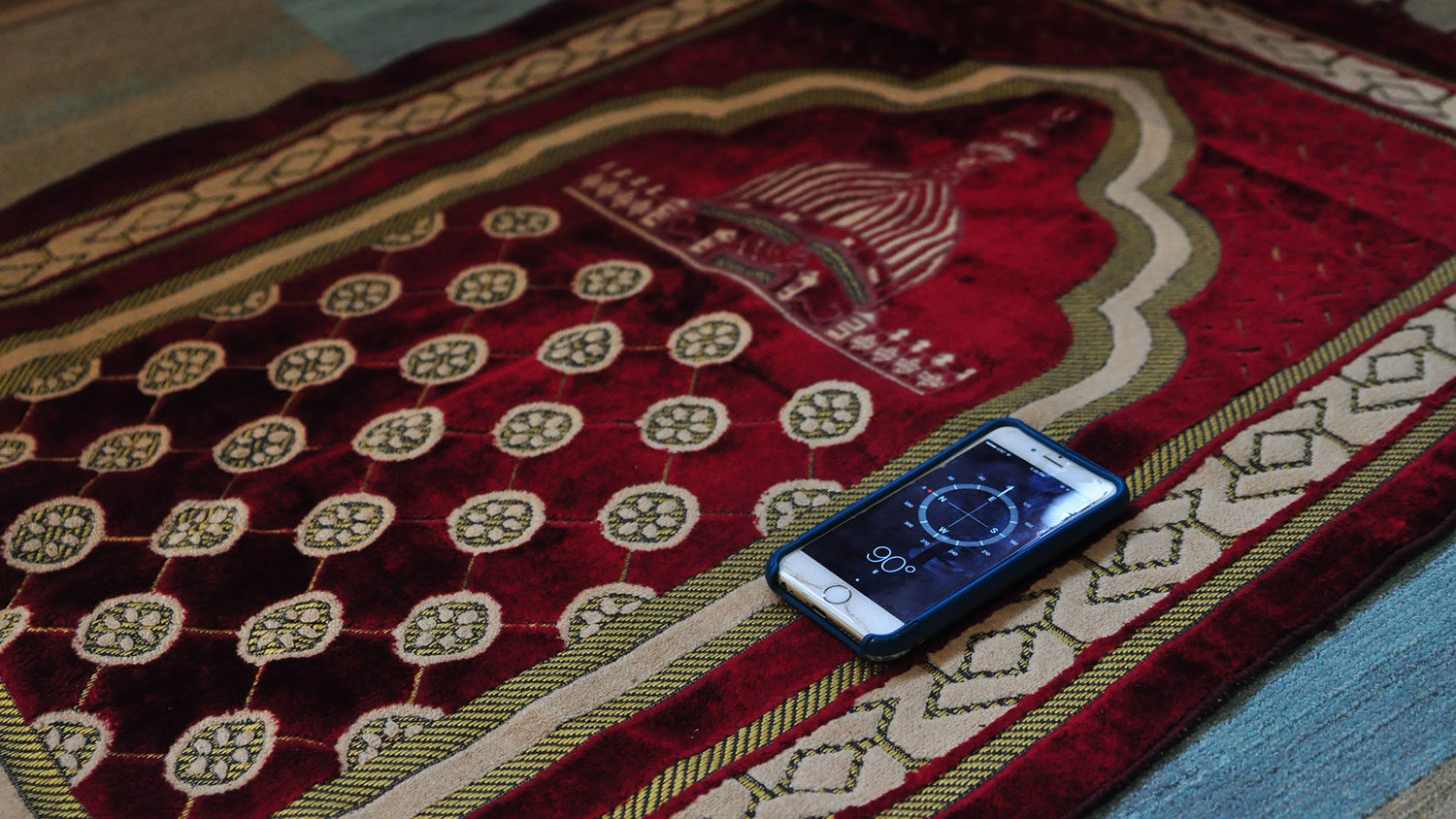 Prayer rug and compass in interfaith prayer space