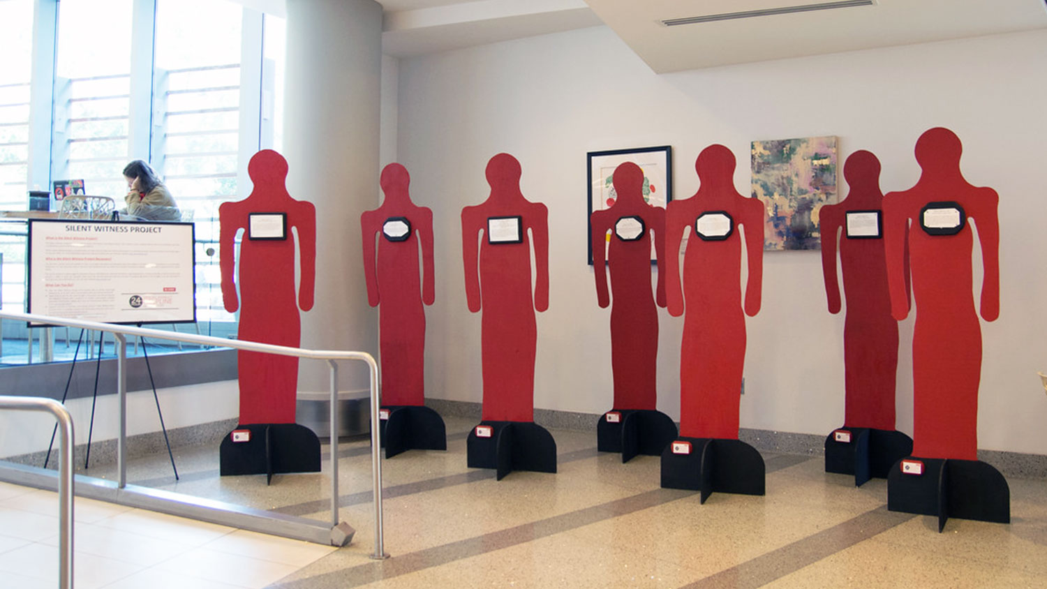 Red cutout figures for Silent Witness Project