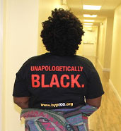 "T-shirt reading ""Unapologetically Black"""