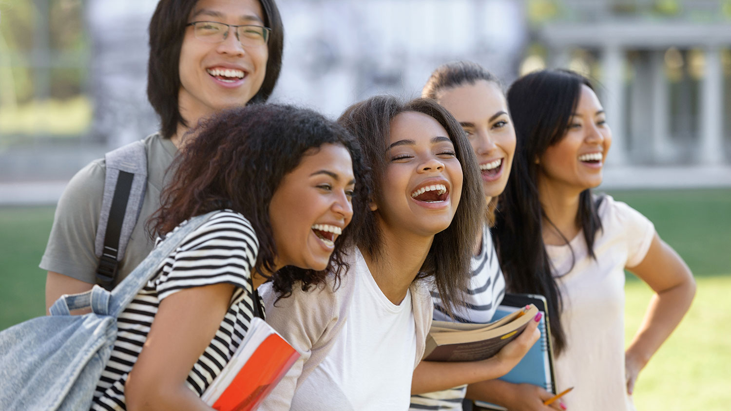 Group of laughing students of color