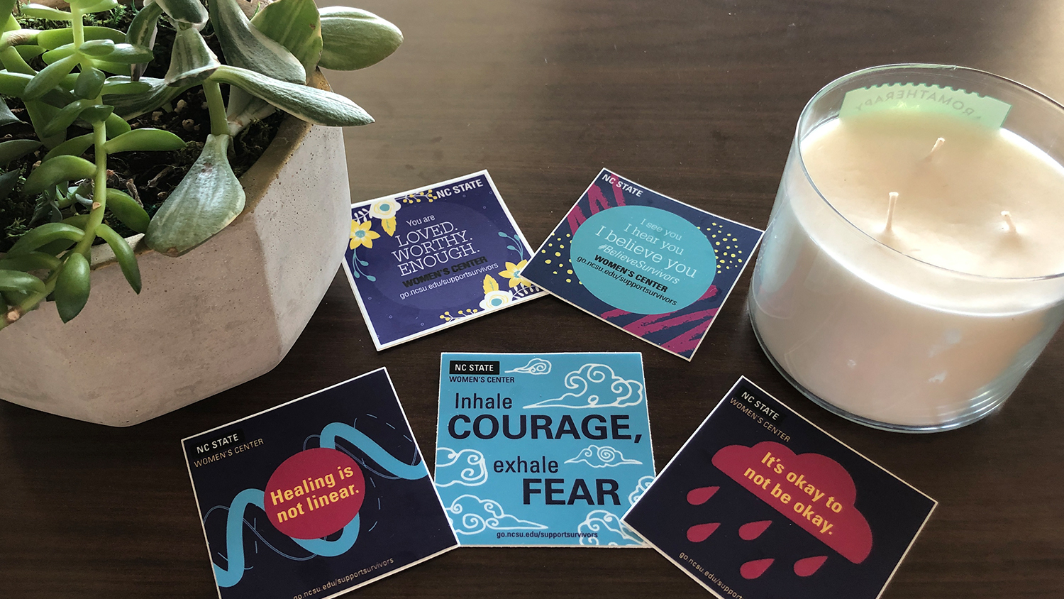 Display of empowering stickers from the Women's Center