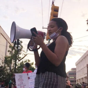 Melanie Flowers, student body president, at a protest with megaphone