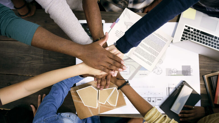 Hands of all skin tones meeting together