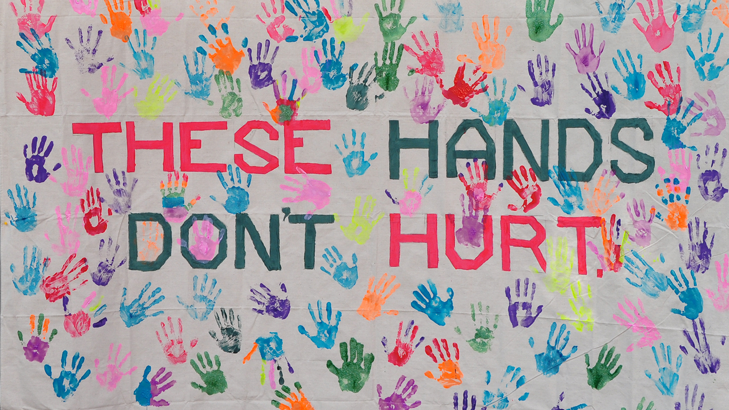 Banner that says These Hands Don't Hurt