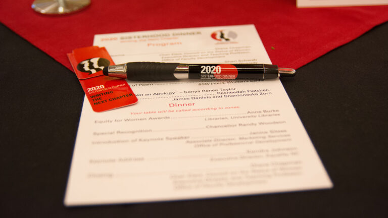 Sisterhood Dinner mementoes on a table at the 2020 event