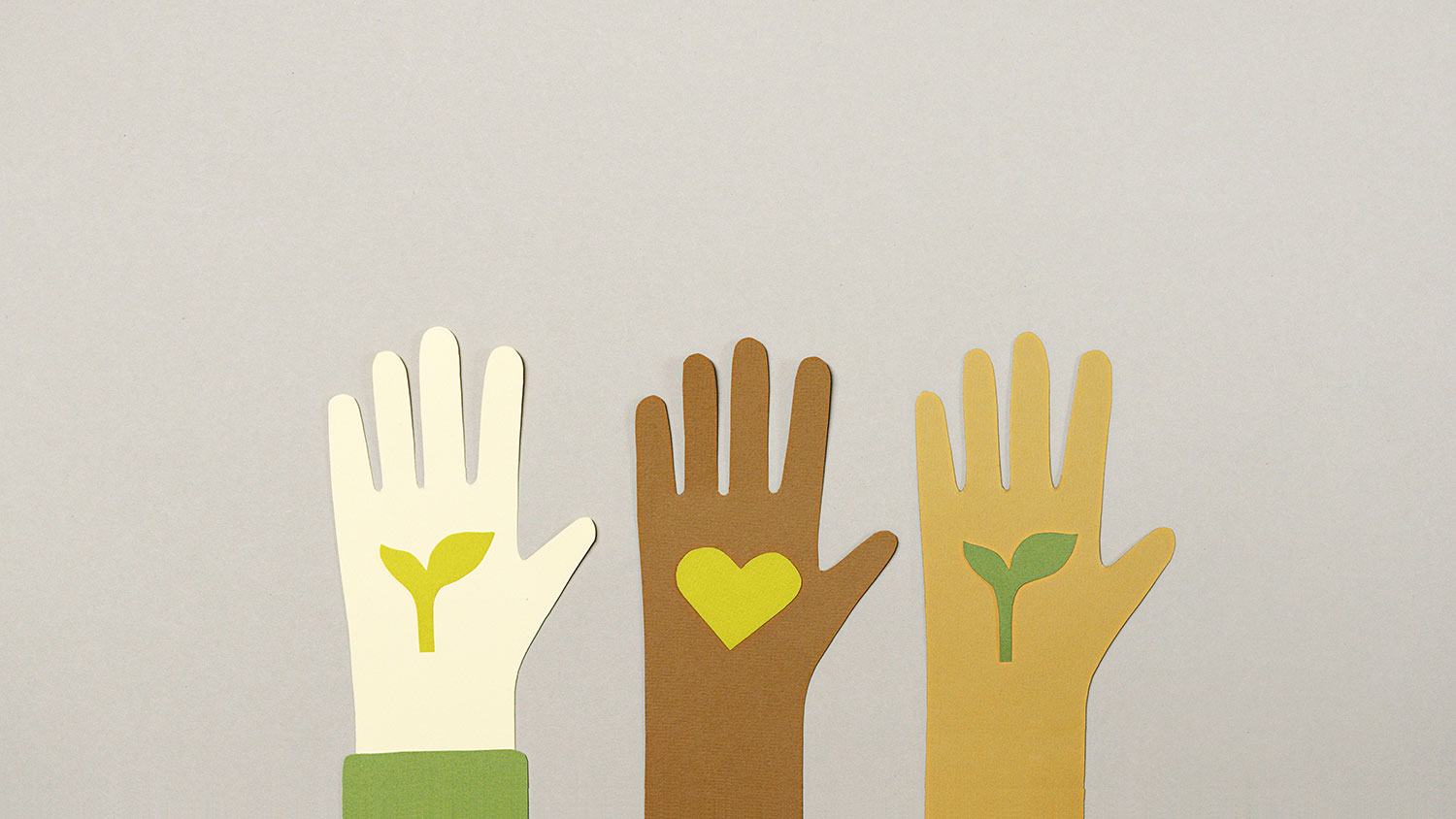 Multicultural hands with plants for Earth Day