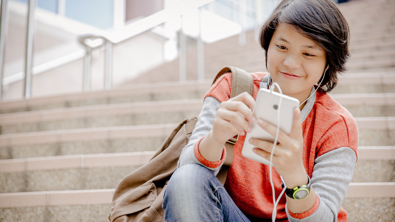 Young Asian woman looking at phone