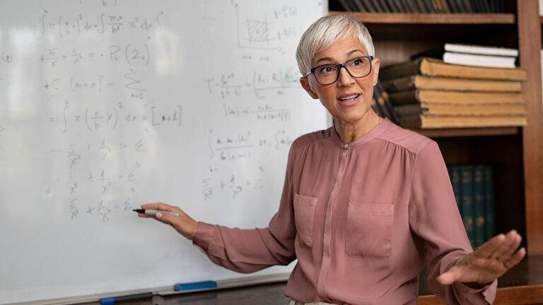 Woman professor at a whiteboard